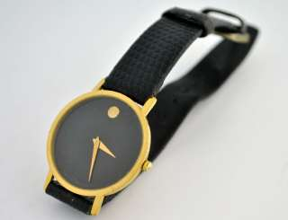 Movado Moderna Ladies Museum Watch Black and Gold Round Face 87 33 882
