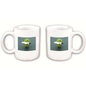 Android Eats Apple Coffee Mug