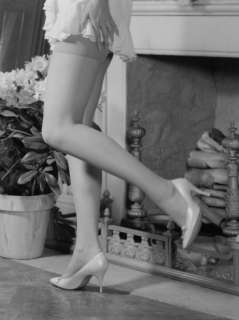 Woman in Mini Skirt and High Heels Dancing By Fireplace Photographic
