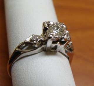14K WHITE GOLD DIAMOND ENGAGEMENT RING ,25 CARATS. PLUS ACCENTS