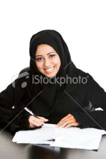 Happy Arabic girl signing papers Royalty Free Stock Photo